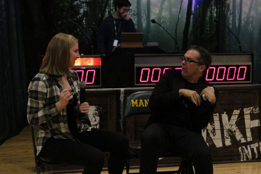 Cassie Riley (11) steals the car keys away from the assemblys host after he attempts to drive drunk during the acting challenge. Riley won the challenge, and had the opportunity to participate in the final round of the assembly.