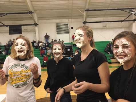 (from left to right) Sage Stevens (11), Andrea Edwards (12), Amelia Mackenzie (12), and Kaitlyn Davidson (11) laugh after having been pied in the face by SMHS council members. Stevens and Davidson were filling in for the executive board members and other seniors who were unable to make it to the game.