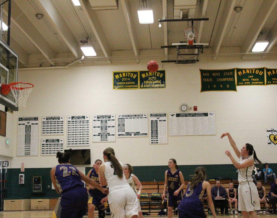 Ariana Olson (12) makes a free throw against Ellicot.