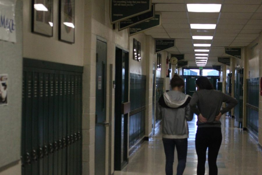 Shelby Megyeri (12) and Ariana Olson (12) walk down freshman hall. The two have been friends for four years.