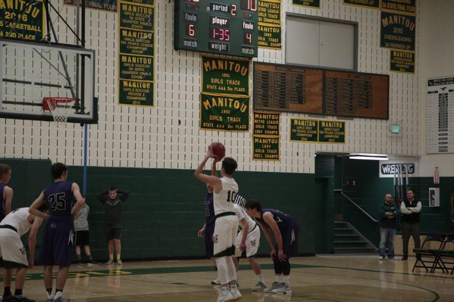 Lucas Rodholm (12) shoots a free throw.