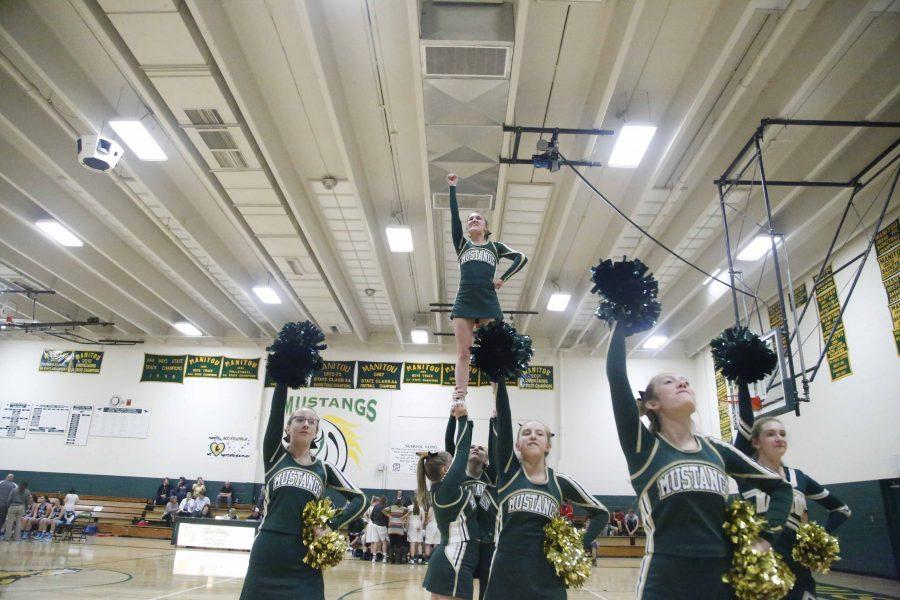 Alyssa Prince(12) flys over fellow cheerleaders at half time during the pigtail basketball game against Trinidad. Both girls and boys basketball  will be at Districts in Pueblo on Saturday and Sunday