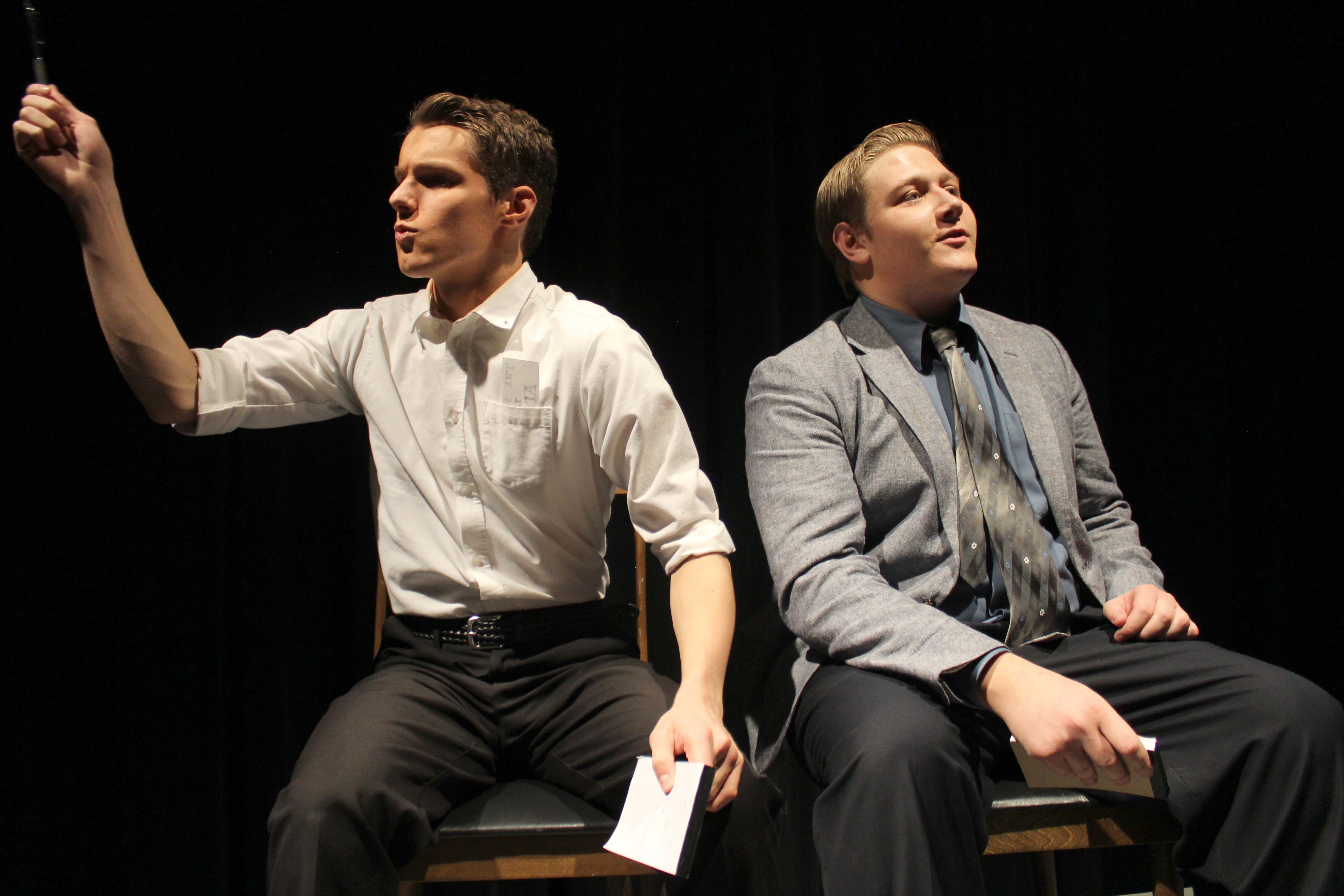 Tyler Doherty (10) and Nathan Plush (11) perform in the Fall Play The Real Inspector Hound.