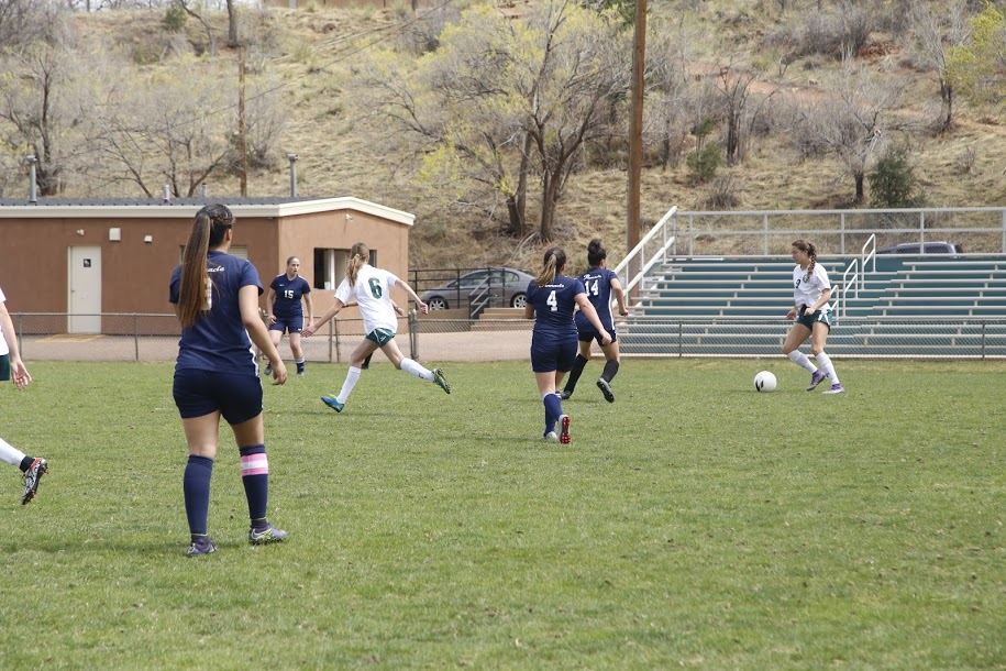 Junior Brooklyn Mack takes control of the ball. Mack has played soccer all three years for Manitou.