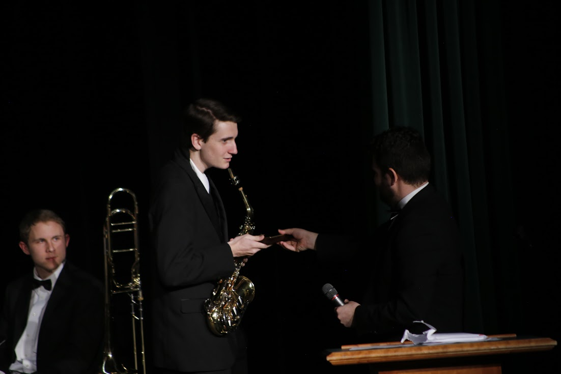 Conor Jayich (11) receives the Woody Herman Jazz Award for his outstanding work. Jayich also qualified for many honor bands through the year, such as the Colorado All State Band.