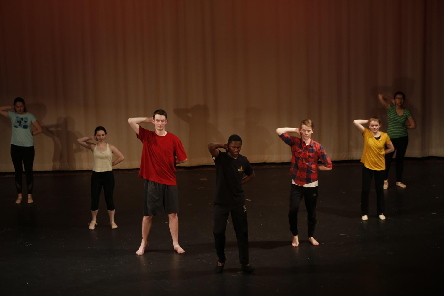 Goodwill Ofori-Atuahene (12) leads Valerija Barkanova (12), McKenna Reid (11), Thomas Hudson (12), Caleb Hall (12), Abi Bebee (10), and Hanny Chairunnisa (12) in a Ghanian style dance choreographed by Ofori-Atuahene, an exchange student from Ghana. He took initiative and asked Nicole Berry, the dance teacher, if he could do a dance for the concert. His dance was performed to