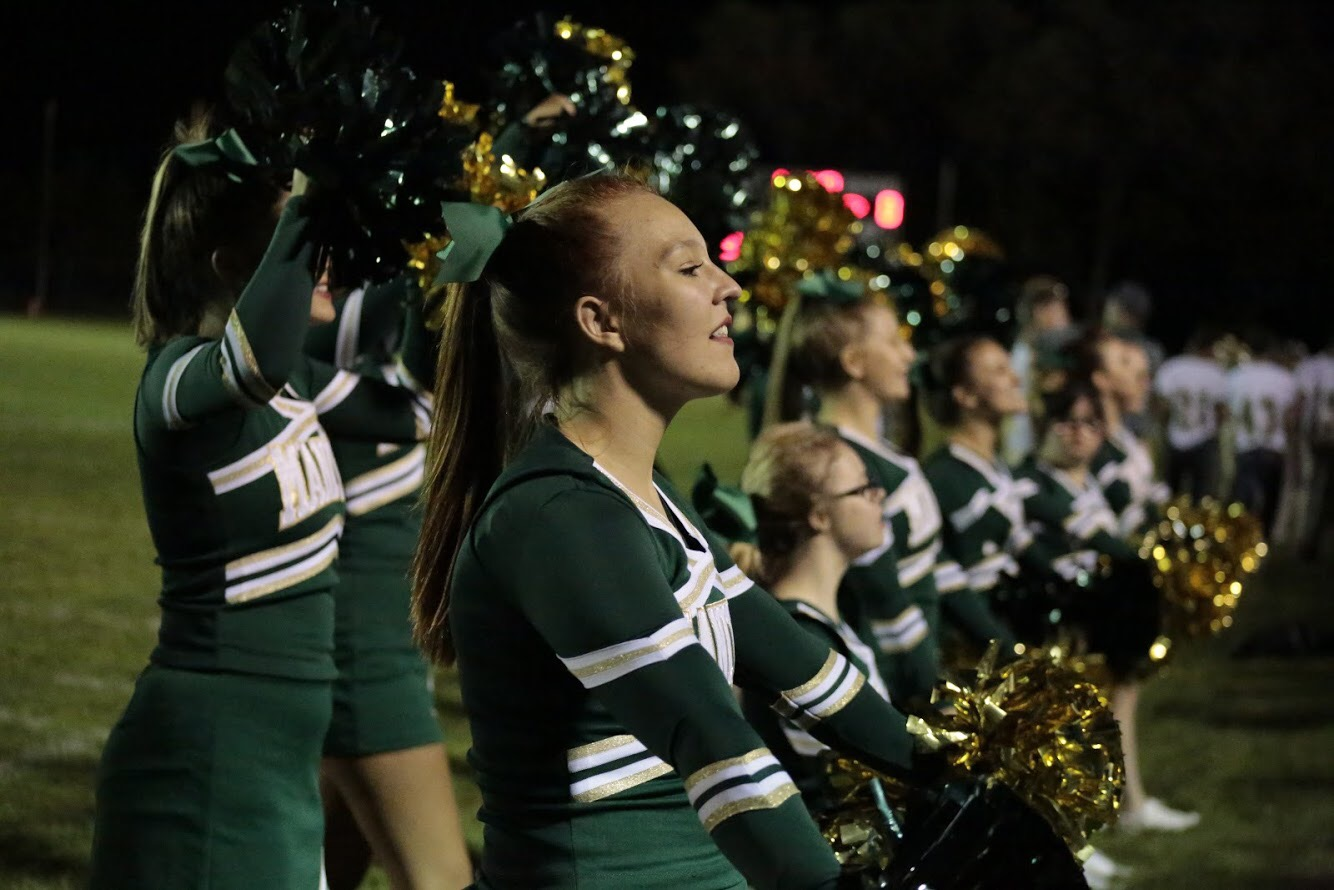 Anela Wright (12) knows that it can be hard for freshmen when they don't get a varsity position right away, but encourages them not to give up. After practicing and trying out for the cheerleading team again, she was immediately put into varsity.