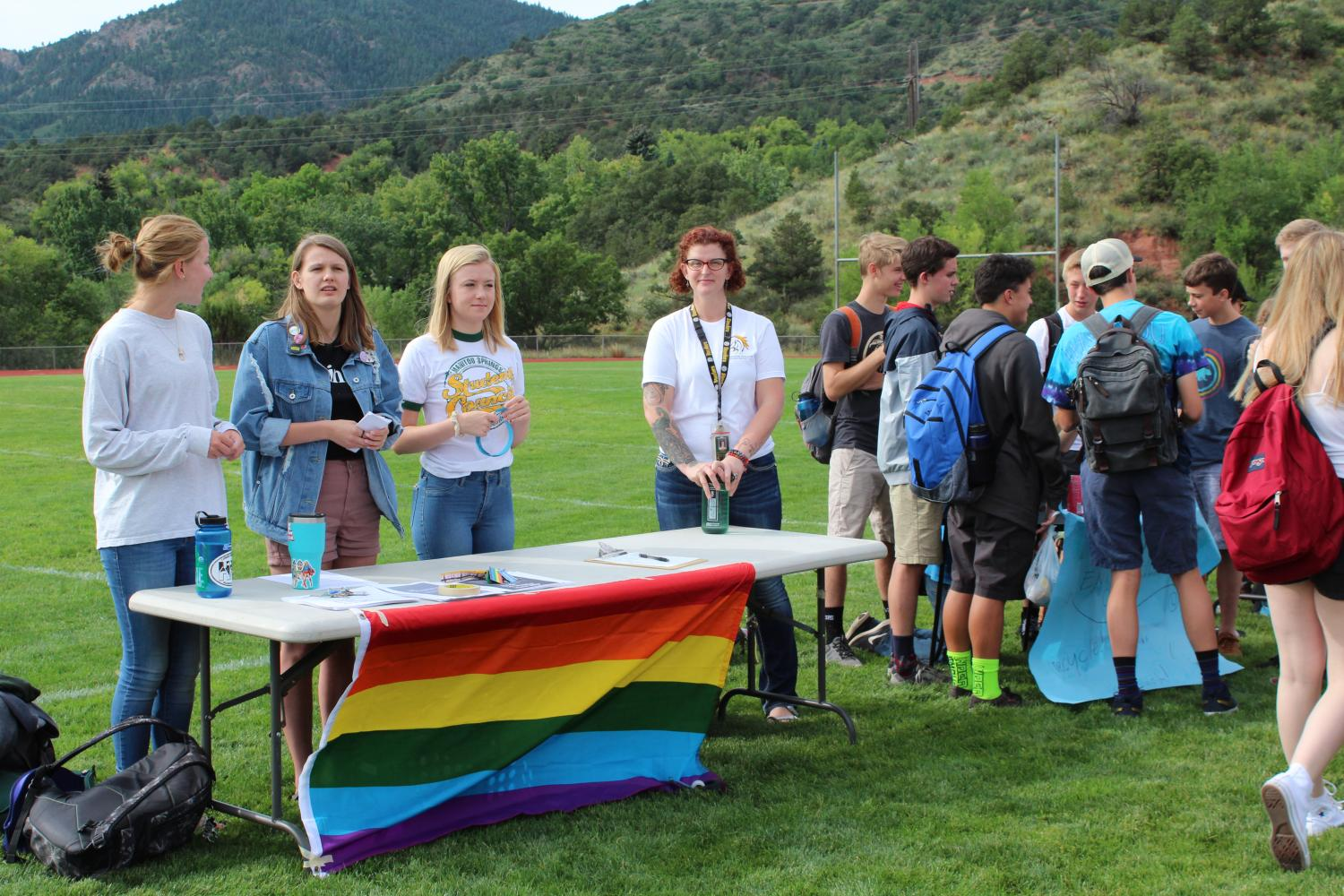 Kaitlyn Cashdollar (11), Aubrey Hall (12) and Jessica Moen (staff), inform people about the purpose and goal of the Gay Straight Transgender Alliance (GSTA). This year they are participating in events such as Urban Peak's Night Out to End Youth Homelessness and Day of Silence.