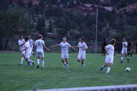 Riley Jungbauer (10) celebrates with his teammates after scoring one of his three goals in the game against Lamar resulting in a hat trick. Jungbauer was on the varsity team his freshman year and is on it again this year, making it his second year of soccer with the high school.