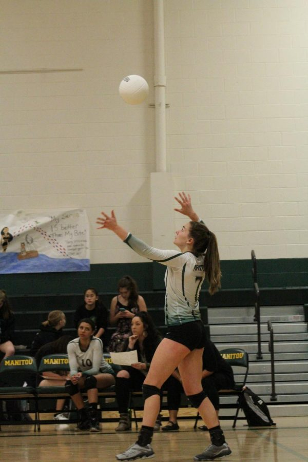 Abbie Boren (11) sets and serves the ball into play. Boren's statistics for the Vanguard game came to four sets played, twenty six assists and six point five assists per set.