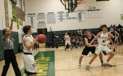 Boys' Basketball Gains First Home Game Win