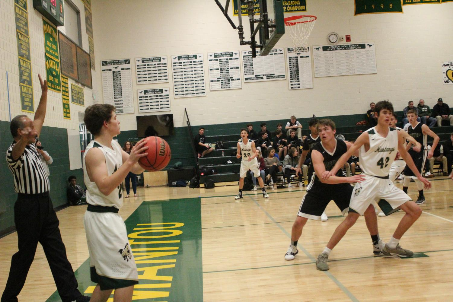 Hunter Zentz (11) calls a play after achieving a foul.