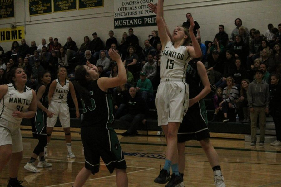 Bridget Bodor (11) goes up for a shot during against St. Mary's players.