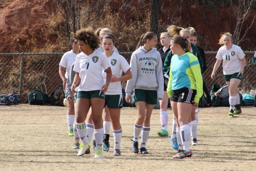 Soccer players warm up before the JV game against Jefferson Academy.