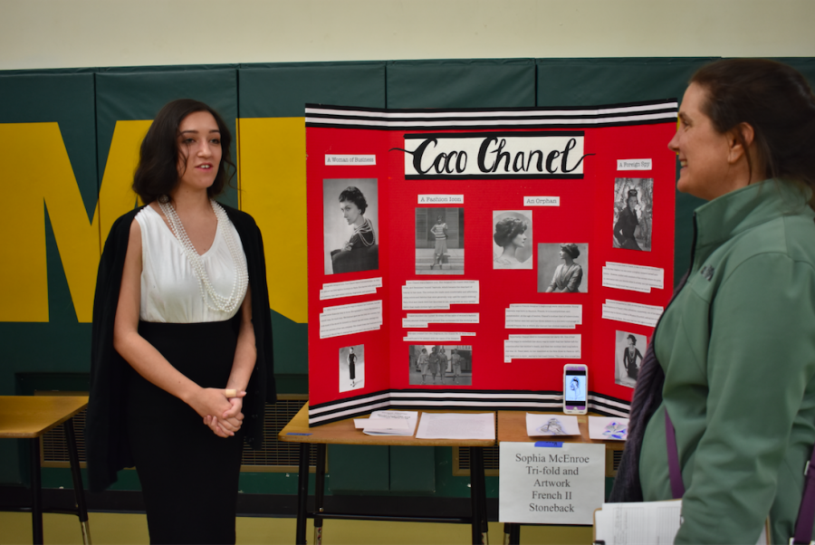 Sophia McEnroe (10) gives her presentation to an onlooker for World Language and Culture Night.