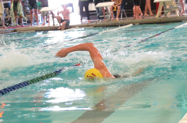 Logan Seward (12) powers through the 100 free which he won with a time of 56.16.