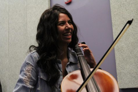 Talia Traxler (11) laughs after finishing a scale on her cello.