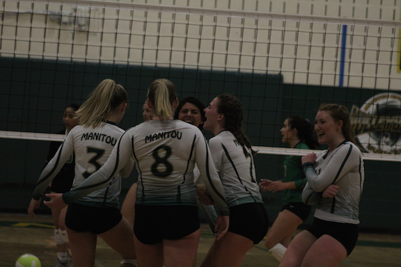MSHS varsity girls celebrate a well earned point. They won the match 3-1.
