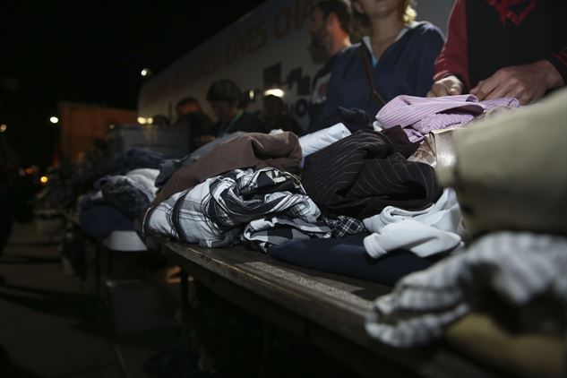 The Dream Center puts donated clothing in a line to be handed out to homeless people.