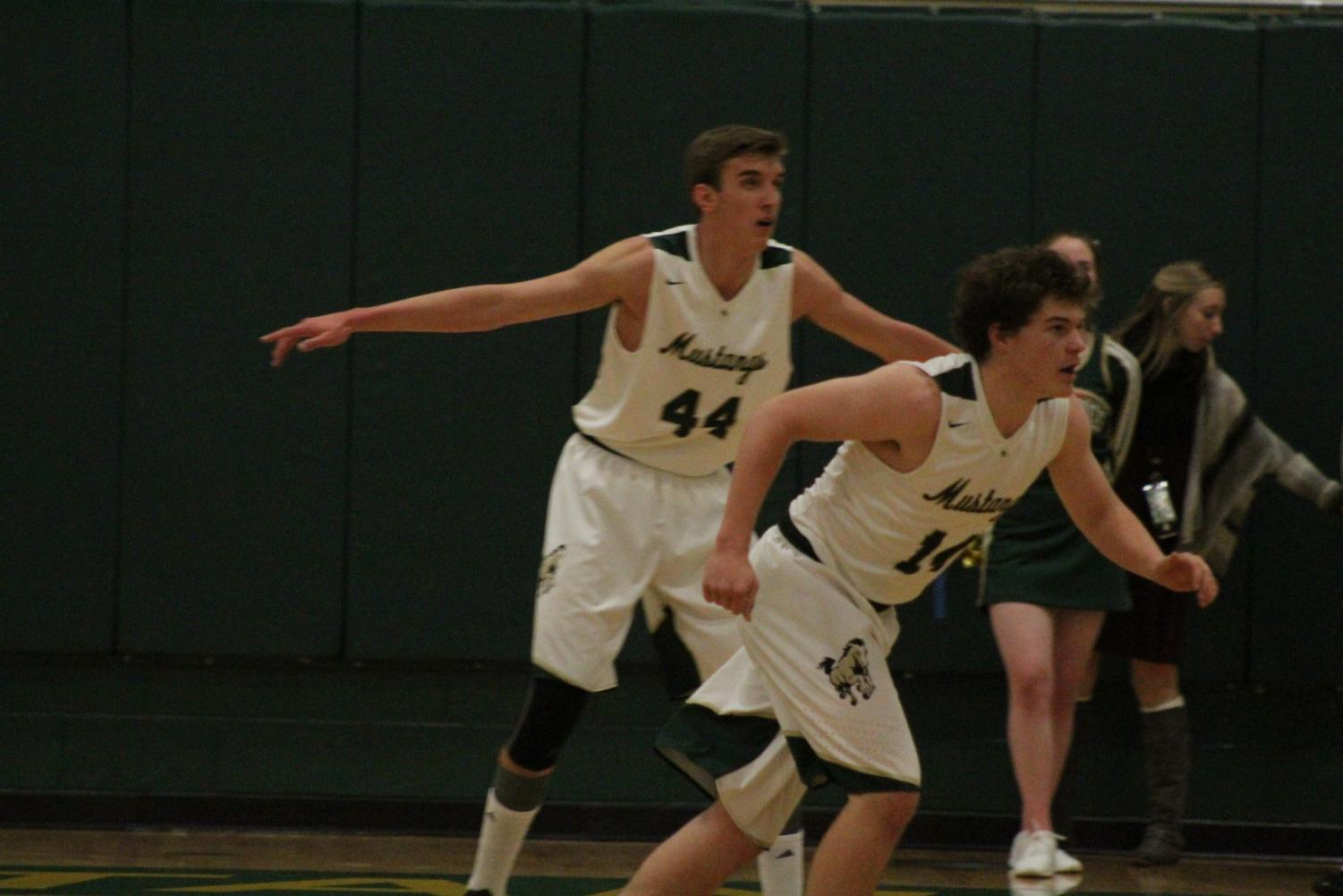 Senior players Hunter Zentz and Zach Perry-Perkins play defense in a game agains CSCS.