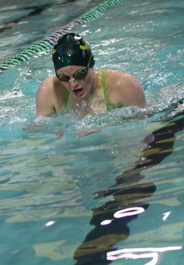 Kaitlyn Cashdollar (12) swims breaststroke, a stroke that requires a unique combination of coordination and technique to do well in. Cashdollar is one of the swim team captains, and has been focused on upping the morale of the team this past season.