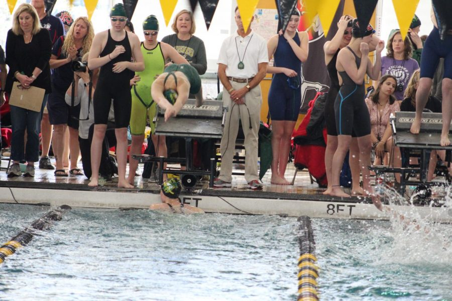 Lindsey+Dwinell+%2810%29+dives+in+after+Sydney+Dolloff-Holt+%2812%29+finishes+during+the+200+freestyle+relay.+MSHS%27s+A+relay+placed+5th+at+3A+State.