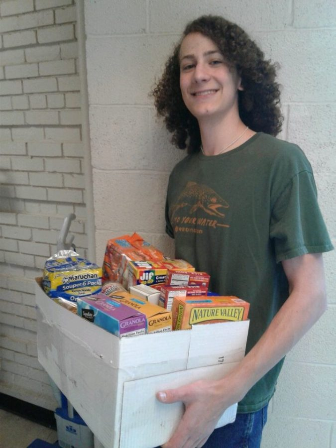 Ben+Schwartz+%2811%29+carries+a+box+of+donated+food+items+into+the+food+pantry+to+unload+at+the+end+of+the+day.