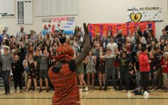 The audience gets involved with the African drum circle song that opened the night. The drum circle was available in the French classroom throughout the night.