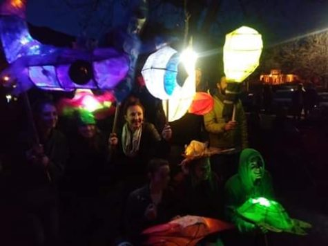 "Students and teachers, Erin Gocinski (art teacher) and Gabrielle Waters (media tech), show off their lanterns made of reed, glue, and tissue paper just before the parade starts on Friday April 5th. ""Projects always end up taking longer than we think they will, this is good because we get ambitious and want to make them better"" said Gocinski."