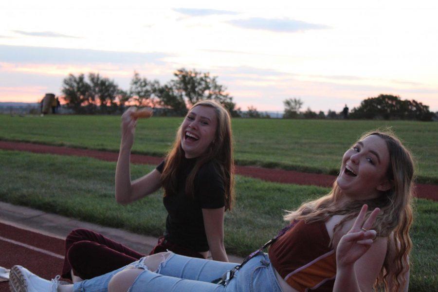Chloe Cupit (12) and Cassidy Ondrejka (12) laugh together while enjoying Senior Sunrise. Senior Sunrise kicked off their last year of high school.