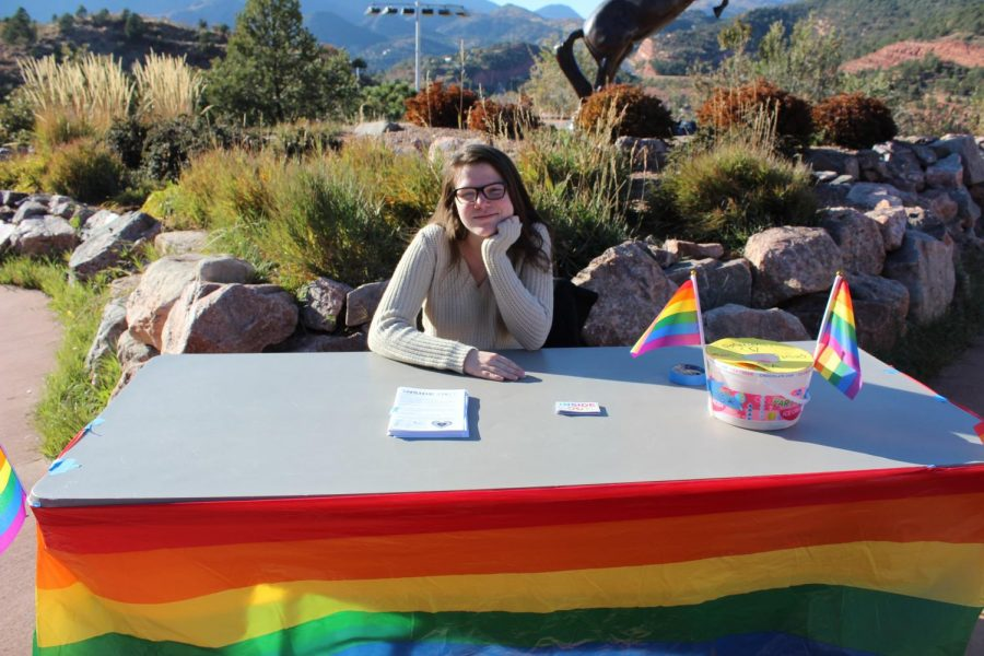 Megan Tribble (9) sits at the GSTA booth at the Tailgate on Friday afternoon. She gave information about one Inside Out Youth Services, one of the organizations that proceeds went to.