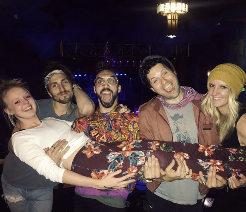 Paige Harrison (10) meeting Magic Giant band members (from left to right) Austin Bisnow, Zango Tango, Zambriki and Audrey Hegert