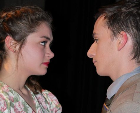 Olive Van Eimeren (10) and Matt Buchenhain (12) stare deeply into each other