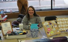 Madeline Davis (12) sits at her CraftzbyMadz booth. At the Craft Fair, she sold stickers and scrunchies that she made herself.