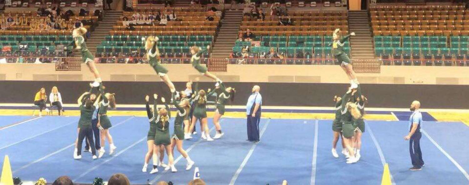 The Cheer Team executed their stunts perfectly at the State Cheer Competition, including this impressive and in-sync lift.