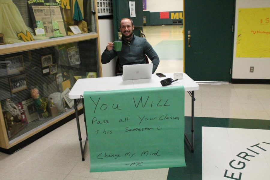 Mr. Moeder-Chandler poses to recreate his meme on Meme Monday. This is his take on the 'Change My Mind' meme.