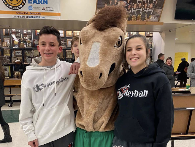 Two incoming freshmen pose with the Manny the Mustang.