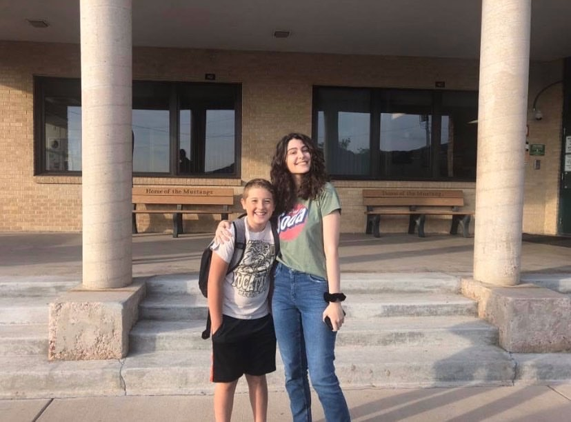 Mariam Gachechiladze (12) poses with her host brother, Ben Perkins, on the first day of school.