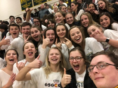 Gideon Aigner (far right) in a selfie with the crowd at the St. Mary's boys' basketball game in January.