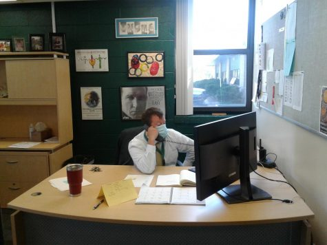 Mr. Hull works from his desk Tuesday triaging the new remote learning schedule.