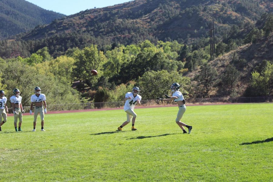 Parker Salladay (11) and Thor Flett (12) participate in The Distraction Drill. This drill teaches receivers to concentrate on the football and work on