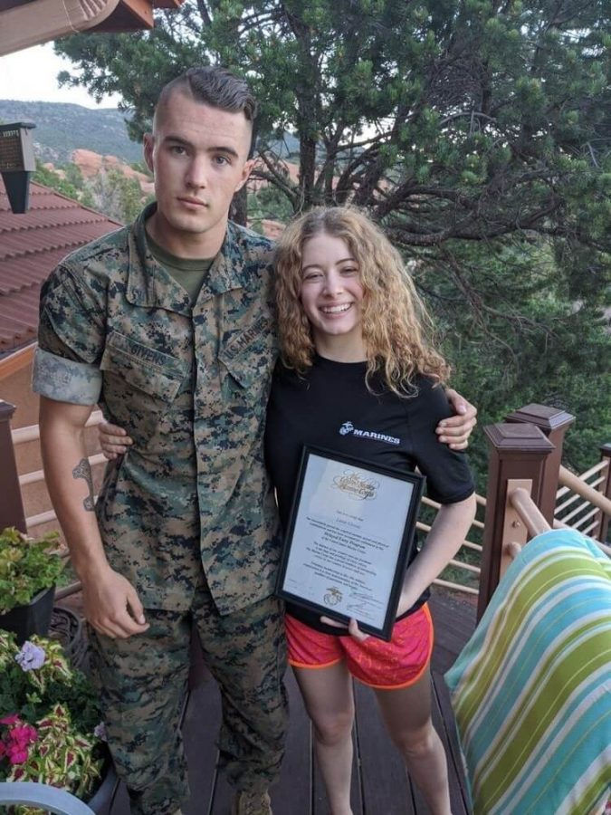 Laine+Givens+%2812%29+poses+with+her+brother+Cade+Givens+%28Class+of+2019%29+and+her+Marine+Corps+contract.