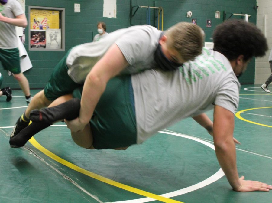 Bradyn Dowling (9) wrestles State qualifier Terry Lindh (11) at practice last week.