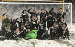 CELEBRATION ENSUES.  After the fans rushed the snowy field, Varsity celebrated in the snow.
