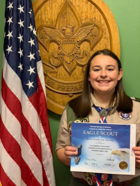 Senior Sierra Dooley receives her official Boy Scout award.  Dooley will celebrate her Eagle Scout Court on Mother's Day.