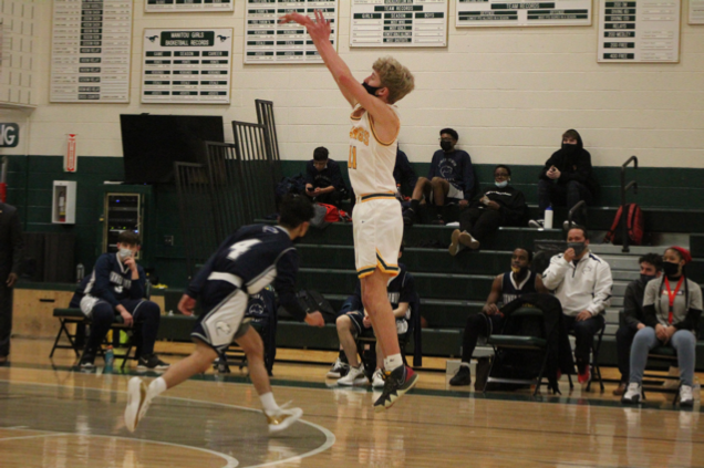 THREE! Senior Thor Flett takes the open three against James Irwin while the James Irwin bench and fans look on.