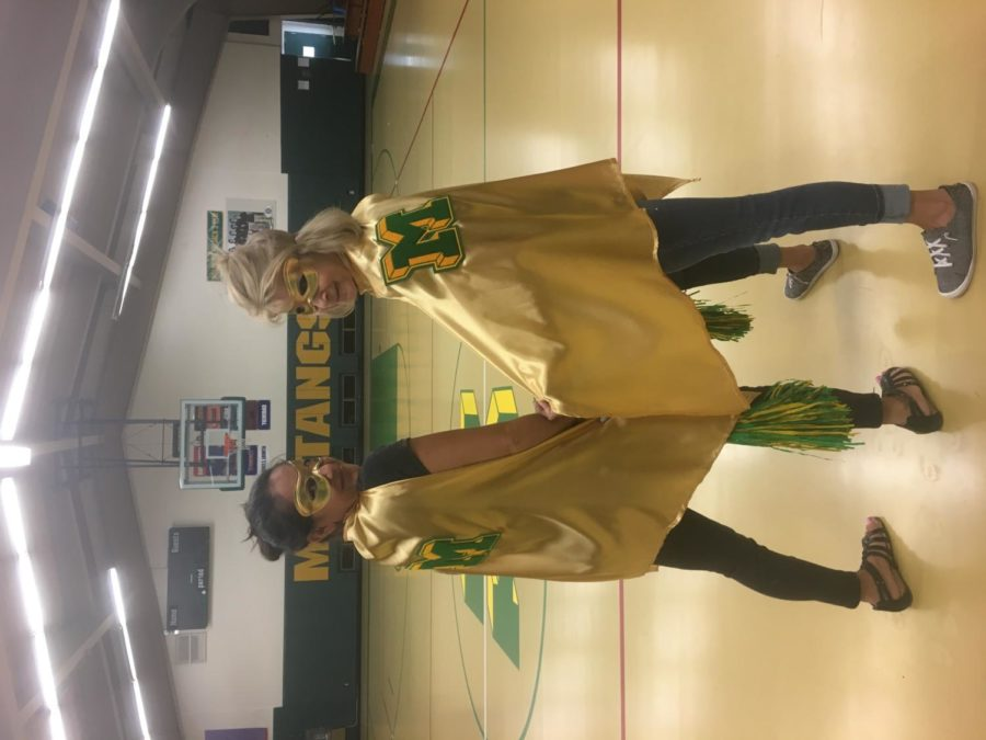 Angie Glass  and Wendy Skokan dressed as superheroes for a student assembly in 2019.