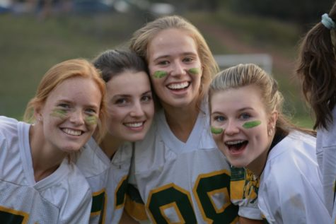 Anna Kilpela (12), Ashley Magee (12), Abigail Parker (12), and Ivory Johnson-Ragan (10), celebrate together after winning the Powderpuff Football game at Richardson Field Tuesday night during glorious Homecoming week.