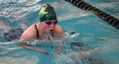 Aidan Coté (12) races breaststroke for the MSHS Girls Swim & Dive team during the winter high school sports season.  Coté trains year round on her club team, the Colorado Torpedoes.
